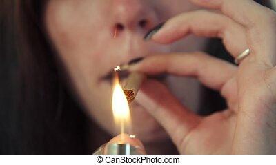 Latina Woman With Lighter Smoking Hashish Joint Marijuana...