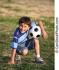 Latino boy with soccer ball