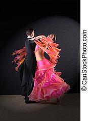 Latino dancers in ballroom against