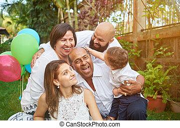 Latino family have fun on garden