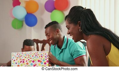 Latino Family With Man Woman Child Celebrating Birthday At Home