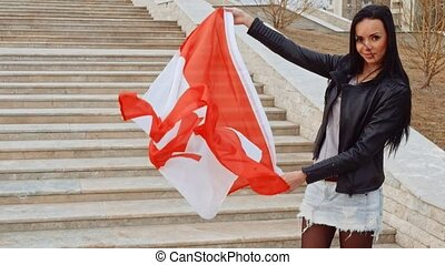 Latino girl activist with waving Canada nation flag in hands...