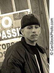 Latino Teenage Boy In An Alley - No Trespassing - A teenage...