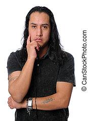 Latino Thinking - Portrait of young Latino thinking