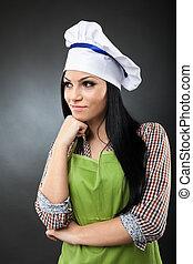Latino woman cook thinking