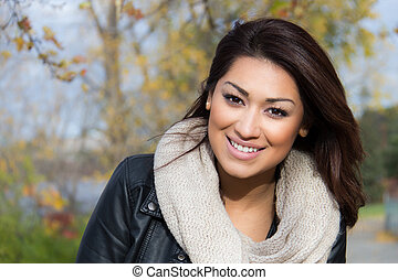 Latino woman outdoors during autumn - Latino woman outdoors...