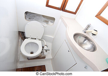 Latrine and shower on sailing boat with toilet paper