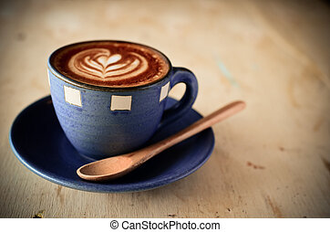 Latte art, Blue coffee cup on wooden background