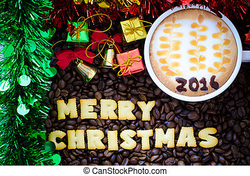 "latte art coffee and alphabet ""merry christmas"" made from bread cookies on coffee beans background"