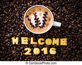 "latte art coffee and alphabet ""welcome 2016"" made from bread cookies on coffee beans background"