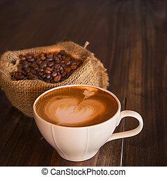 coffee - Latte art coffee with coffee bean on wood tabel