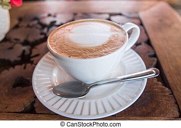 Latte coffee on wood table