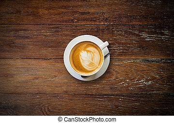 latte coffee on wood table.