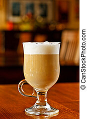 Latte coffee served on bar table