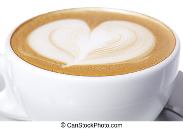 Studio shot latte cup with hear design.