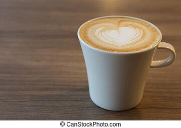 Latte art coffe heart milk