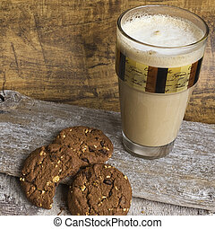 milk coffee in glas and cookies