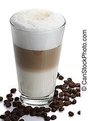 latte macchiato with coffee beans on white background
