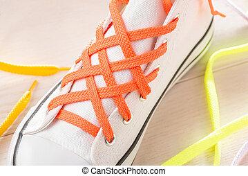 Lattice lacing of white sneaker