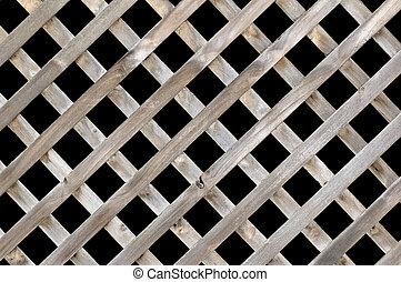 Lattice screen - A lattice wooden fence isolated on black.