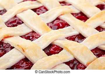 Lattice Top Cherry Pie Macro - The top of a golden brown...