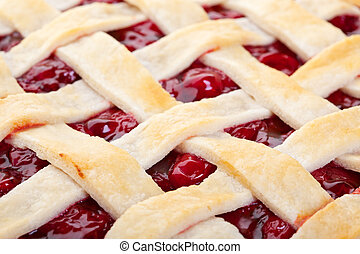Lattice Top Cherry Pie Macro - The top of a golden brown...
