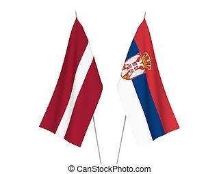 Latvia and Serbia flags - National fabric flags of Latvia...