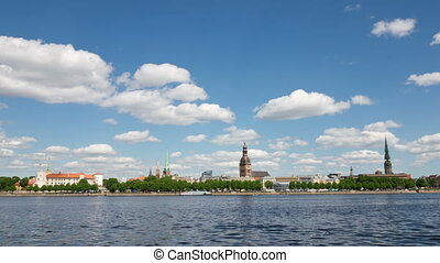 Latvia. Clouds move on the blue sky over Riga and Daugava river.Timelapse