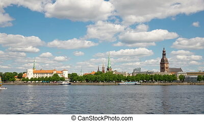 Latvia. Clouds move on the blue sky over Riga and Daugava river.Timelapse,