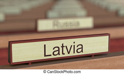 Latvia name sign among different countries plaques at...