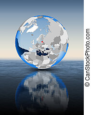 Latvia on globe in water