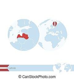 Latvia on world globe with flag and regional map of Latvia.