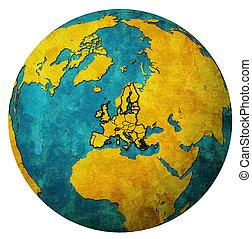 latvia territory with flag over globe map