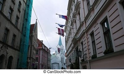 Latvian, UK, EU and russian national flags at Riga old town,...