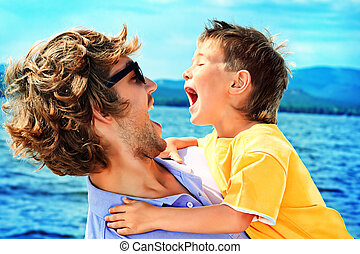 laugh heartily - Portrait of a happy father with his little ...