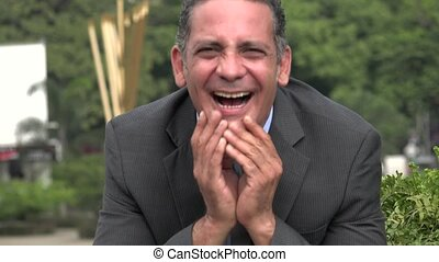 Laughing Adult Hispanic Businessman