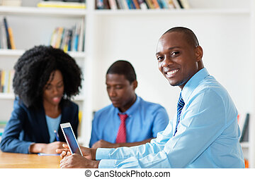 Laughing african american financial advisor with business team