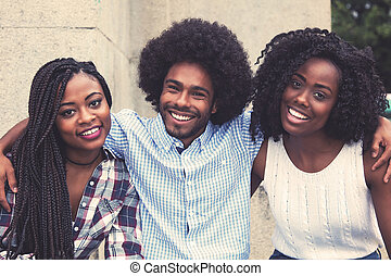 Laughing african american hipster man with two beautiful woman