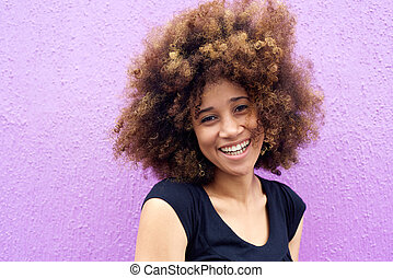 Laughing african american woman with afro