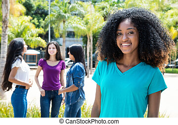 Laughing african american woman with group of girlfriends