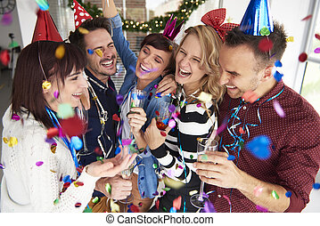 Laughing and celebrating the new years eve