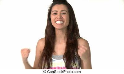 Laughing asian woman celebrating