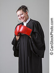 laughing at fight - woman in her thirties, wearing a black...