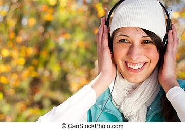 attractive woman listening music