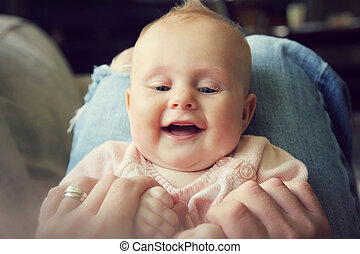Laughing Baby Girl Holding Fathers Hands