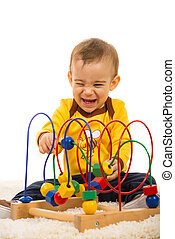 Laughing baby having fun with toy
