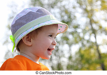 laughing baby in hat outdoor