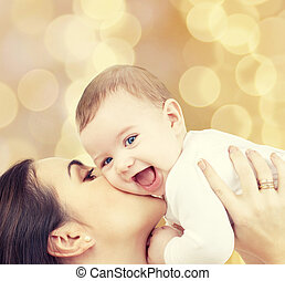 laughing baby playing with mother