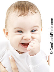 laughing baby - bright closeup portrait of adorable baby