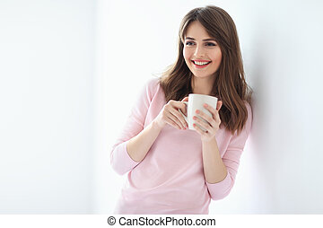 Laughing beautiful woman with cup of coffee on white background